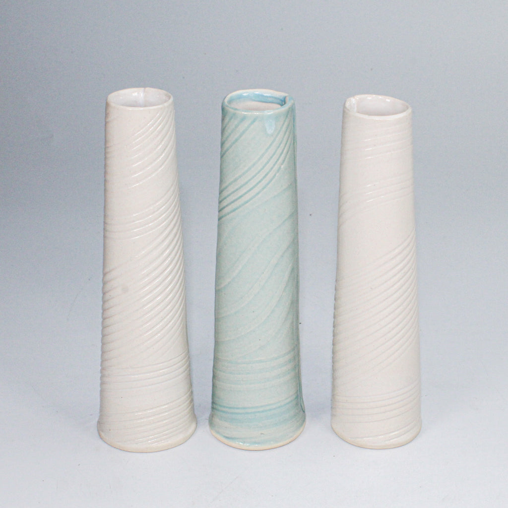 Trio of porcelain single stem vases, two white, one baby blue