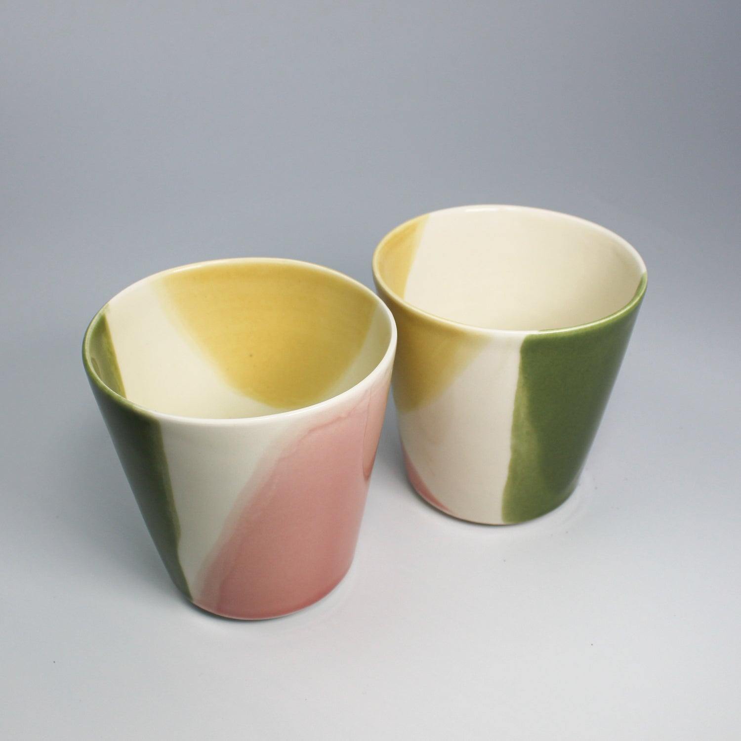 Pair of multi-coloured cups