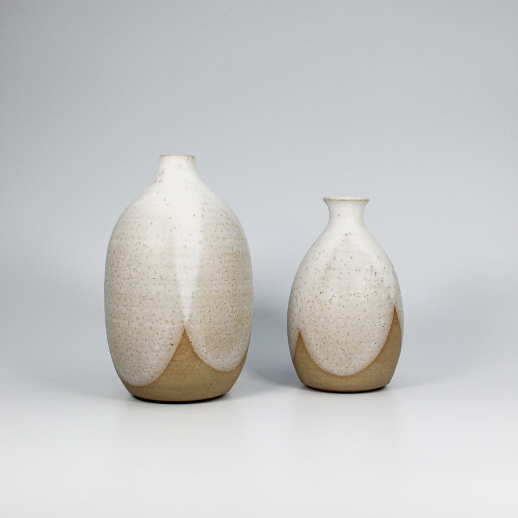 Pair of pottery vases with white dripped glaze