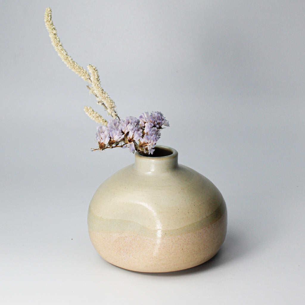 Small ceramic wasi sabi vase with small flowers in