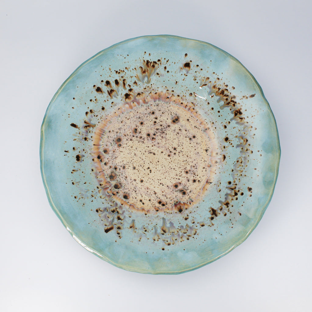 Large blue and beige glazed pottery platter with  wavy edges