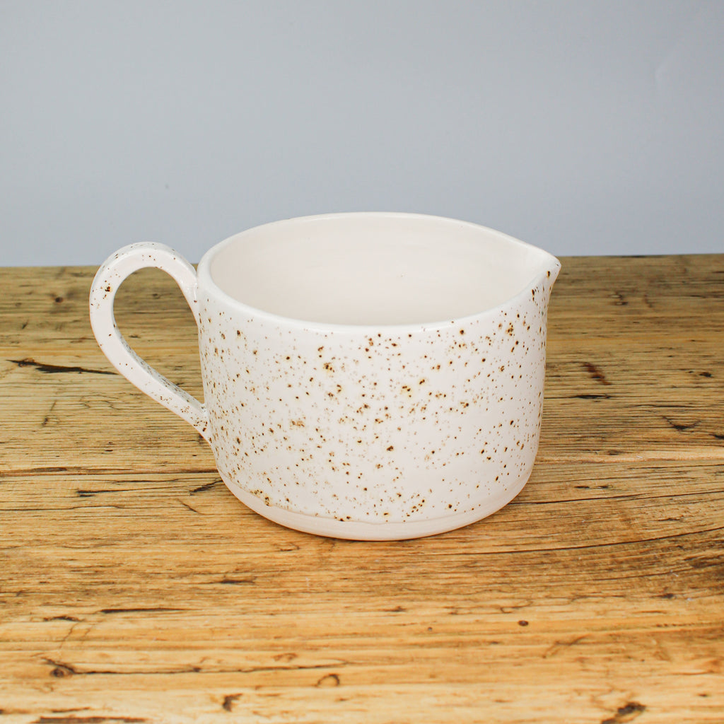 White and gold flecked pottery jug