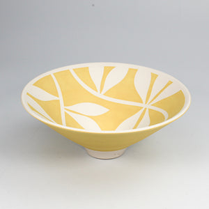 Yellow porcelain bowl with white leaf pattern