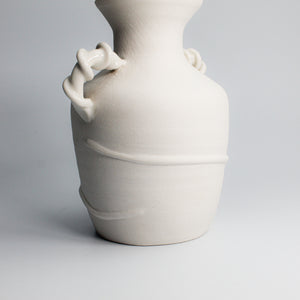 Porcelain twisted vase with dried flowers
