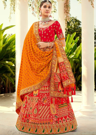 Candy Red Heavy Embroidered Banarasi Silk Lehenga Choli