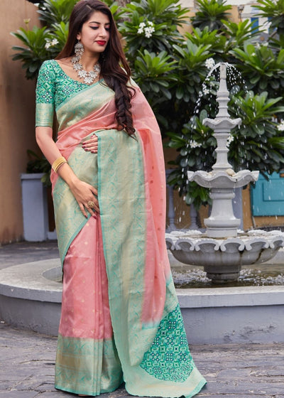 Salmon Pink Woven Banarasi Silk Saree with Patola Pallu and Blouse