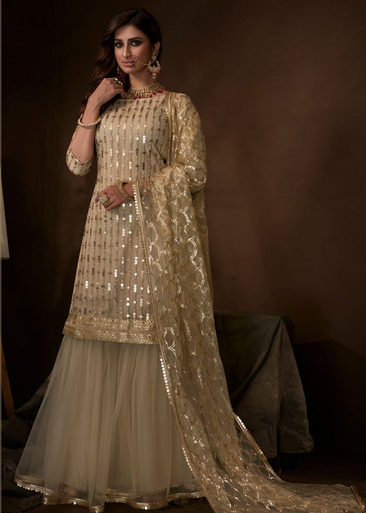 Dusky Beige Designer Soft Net Sharara Suit with Sequin and Zari work