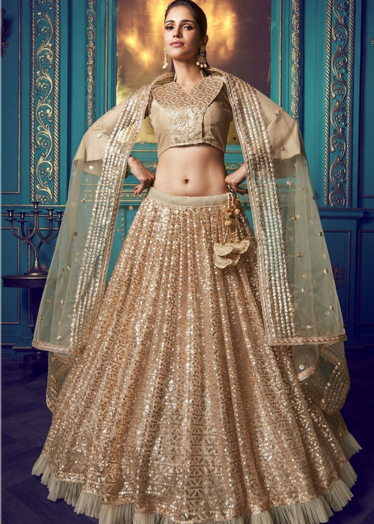 Golden Designer Soft Net Lehenga Choli with Ruffles and Sequin work