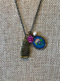 Handmade nesting doll necklace