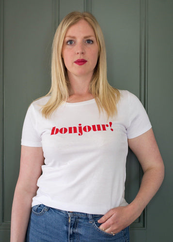 Hannah wearing red bonjour slogan white t-shirt