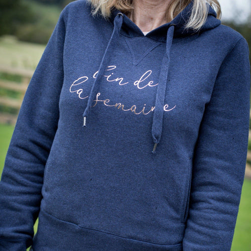 women's navy hoodie with 2 pockets and fin de la semaine slogan in rose gold foil