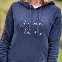 Load image into Gallery viewer, women's navy hoodie with 2 pockets and j'aime la vie slogan in silver