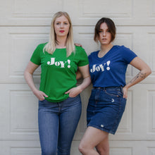 Load image into Gallery viewer, Hannah and Daisy wearing blue and green Joy slogan short sleeve t-shirts in front of garage door