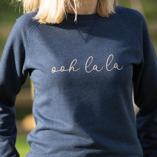 women's navy crewneck organic cotton and recycled polyester sweatshirt with ooh la la slogan text in gold
