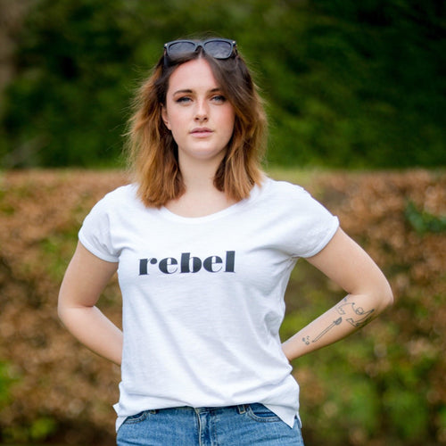daisy wearing white t-shirt with black rebel slogan