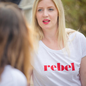 Hannah in short sleeve white t-shirt with red rebel slogan