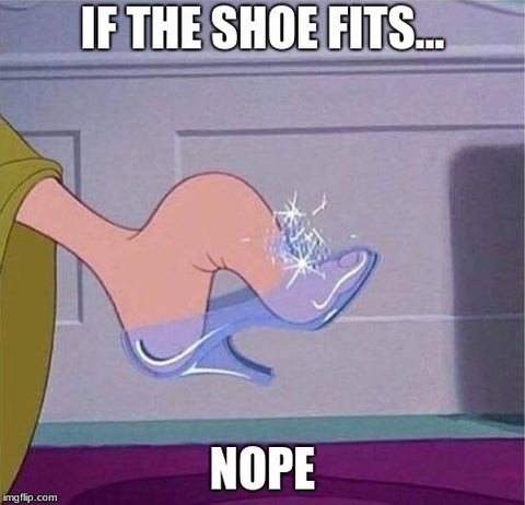cinderella's step sister trying to shove big foot into glass slipper