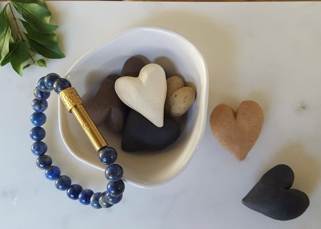 White ceramic bowl and hearts with Hidden Affirmations Bracelet