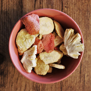 A bowl of Snack Gardens Tropical Freeze-Dried Fruit Mix made from all natural ingredients.