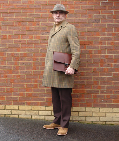 "Eric Musgrave with a Holdall & Co 14"" London Tan Folio"