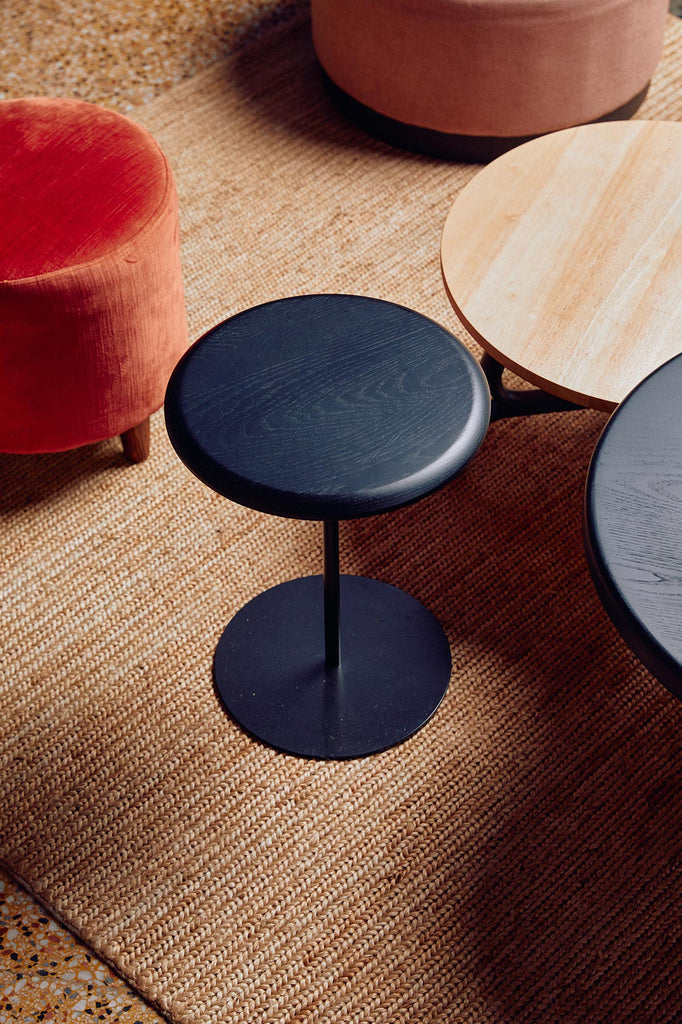 Stools and ottomans on rug