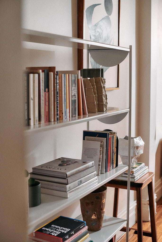 bookshelf with books and vases