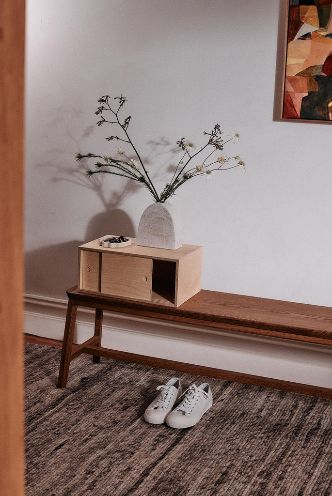 bench with flowers and cabinet