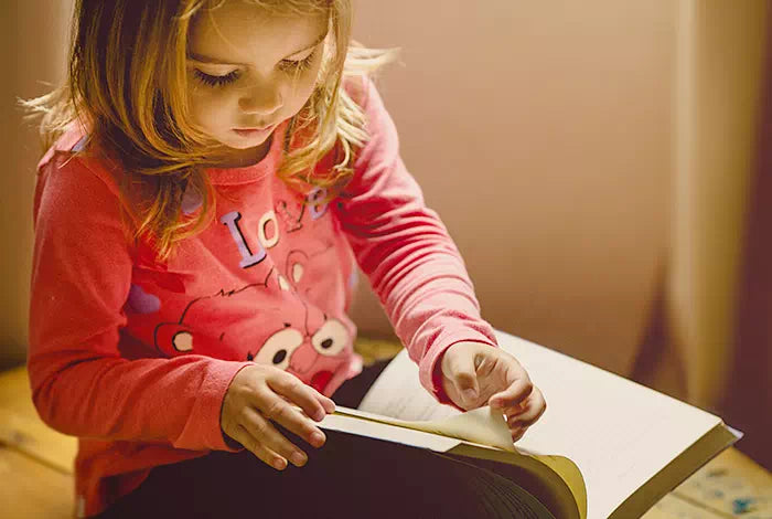 misrepresented girl reading book