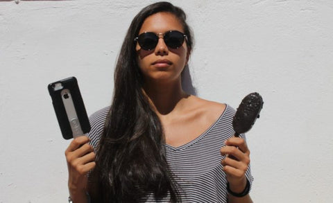 Girl holding POPSICASE phone case and popsicle