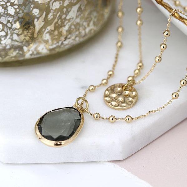 Gold plated disc and smoky crystal layered necklace