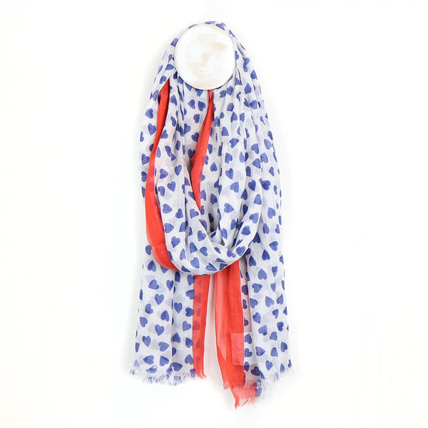 Blue and white heart scarf with red border