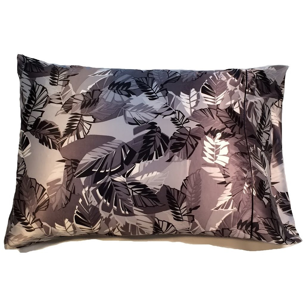 This A Touch of Satin pillowcase is made from a gray, silver and black leaves charmeuse satin print, sewn with French seams and is washable and dryer safe.