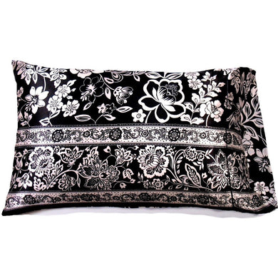 This A Touch of Satin pillowcase is made from a black and white flowers charmeuse satin print, sewn with French seams and is washable and dryer safe.