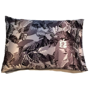 "This travel pillow is made from a gray, black and white leaves satin print. The pillow feels ""down filled"" and is hypo-allergenic. The pillow and pillowcase are washable."