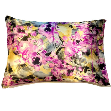 This decorative throw pillow is made from a yellow, black, pink satin print. The pillow feels