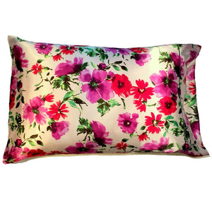 "This satin pillow is made from a purple, pink and green flowers satin print. The pillow feels ""down filled"" and is hypo-allergenic. The pillow and pillowcase are washable."