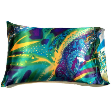 This designer pillow is made from a green, yellow and purple satin print. The pillow feels