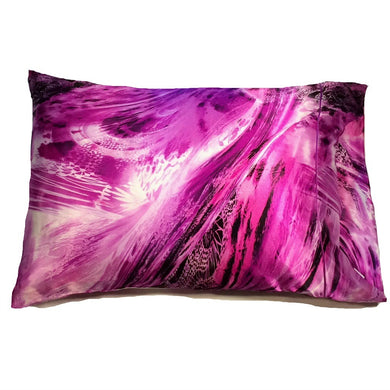 This bedroom accent pillow is made from a pink, purple and black  satin print. The pillow feels