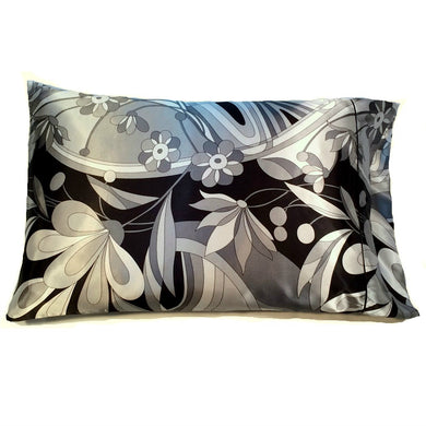 This decorative pillow is made from a black with gray flowers satin print. The pillow feels