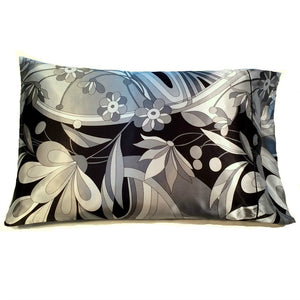 "This decorative pillow is made from a black with gray flowers satin print. The pillow feels ""down filled"" and is hypo-allergenic. The pillow and pillowcase are washable."