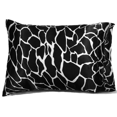 This accent pillow is made from a black and white giraffe charmeuse  satin print. The pillow feels