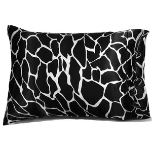 "This accent pillow is made from a black and white giraffe charmeuse  satin print. The pillow feels ""down filled"" and is hypo-allergenic. The pillow and pillowcase are washable."