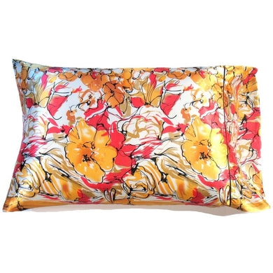 This sofa throw pillow is made from a yellow and pink  satin print. The pillow feels