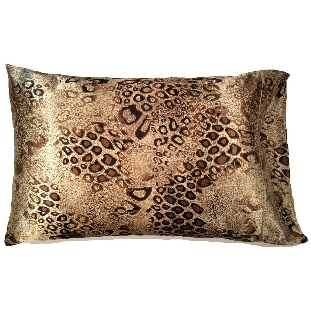 This bedroom pillow is made from a brown and beige leopard charmeuse  satin print. The pillow feels