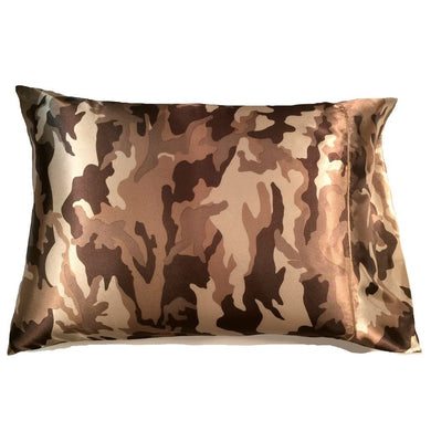 This travel pillow is made from a brown, beige and tan camouflage satin print. The pillow feels