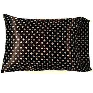"This accent pillow is made from a black with white and red diamonds satin print. The pillow feels ""down filled"" and is hypo-allergenic. The pillow and pillowcase are washable."