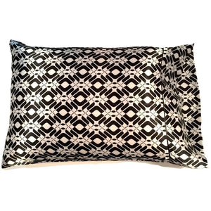 "This sofa accent pillow is made from a black and white charmeuse  satin print. The pillow feels ""down filled"" and is hypo-allergenic. The pillow and pillowcase are washable."