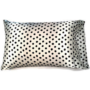 "This travel pillow is made from a white with black polka dots satin print. The pillow feels ""down filled"" and is hypo-allergenic. The pillow and pillowcase are washable."