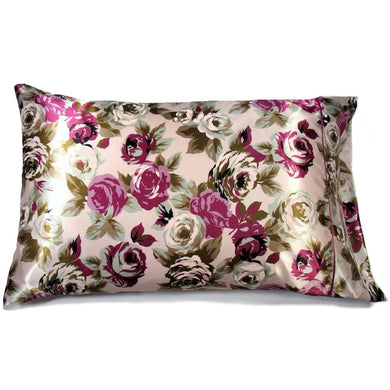 This accent pillow is made from a purple and green flowers  satin print. The pillow feels