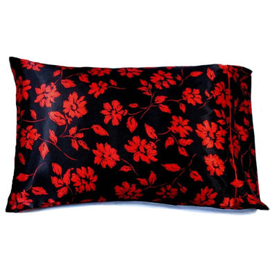 This bedroom pillow is made from a black with red flowers  satin print. The pillow feels
